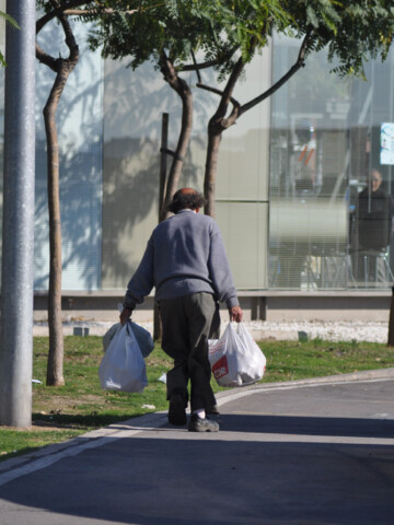 man carrying bags