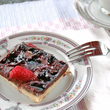 overhead view of slice of Chocolate Strawberry Cookie Bar on a plate with fork
