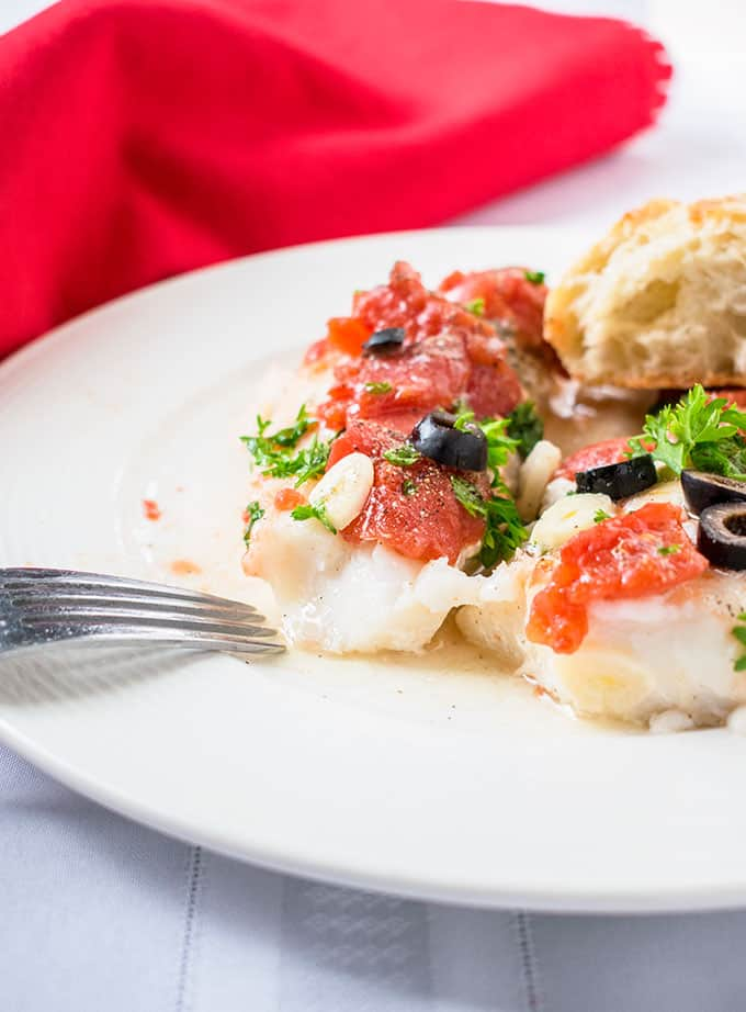 Photo of Sauteed Cod with Tomatoes in Plate with Fork