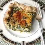 slice of spinach ricotta pie on a plate with fork