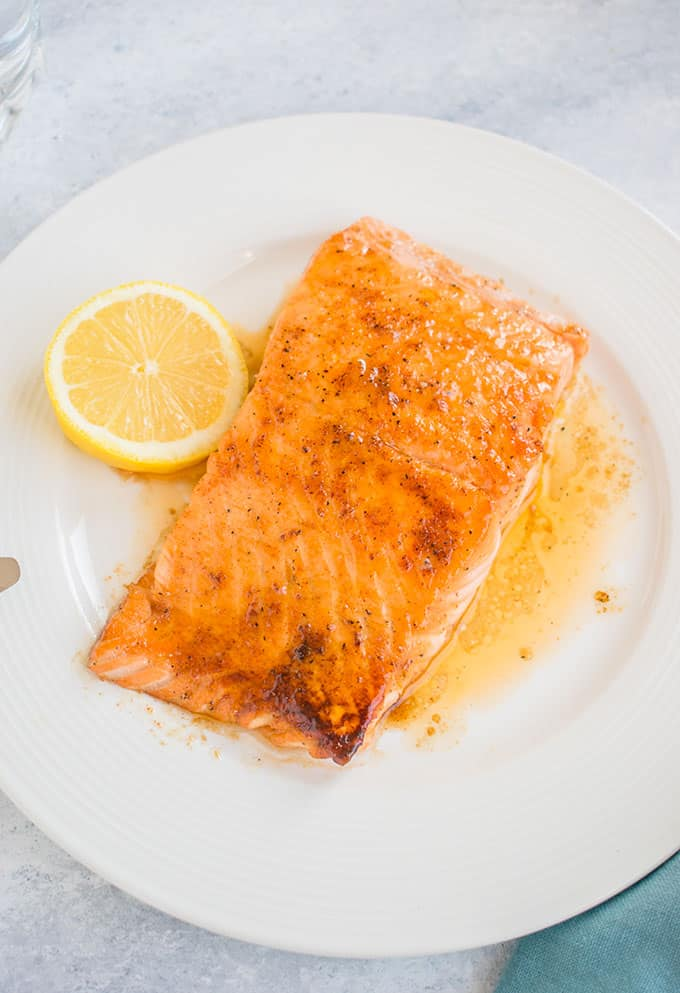 overhead view of 10-minute maple-glazed salmon with slice of lemon