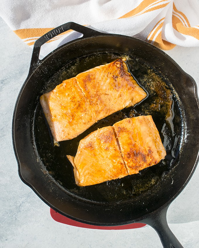 Overhead photo of cast iron skillet with 10-Minute Maple-Glazed Salmon