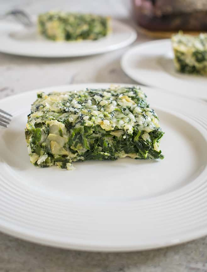 Photo of three plates of Creamed Spinach Souffle with Artichokes