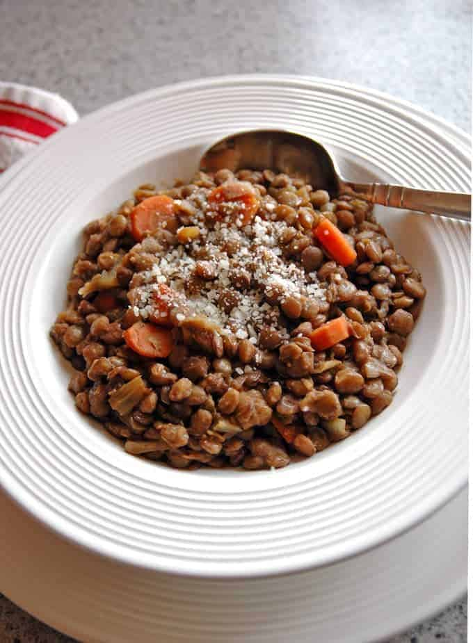 Smoky Lentil Stew in a bowl with spoon