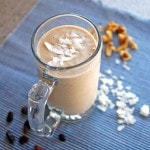 Banana Nut Oatmeal Raisin Smoothie with Coconut in a glass mug