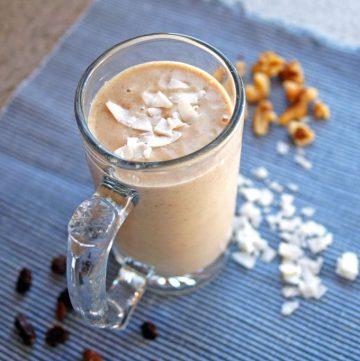 Banana Nut Oatmeal Raisin Smoothie with Coconut in a glass mug