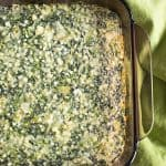 Photo of glass pan of Creamed Spinach Souffle with Artichokes