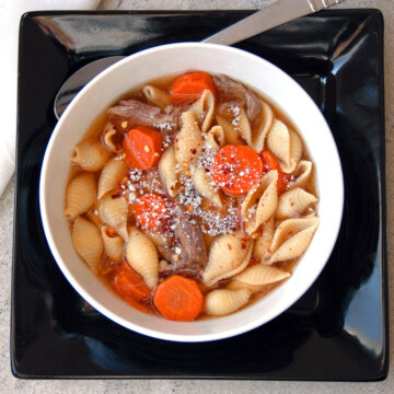 Italian Beef Soup with Pasta Shells in a bowl