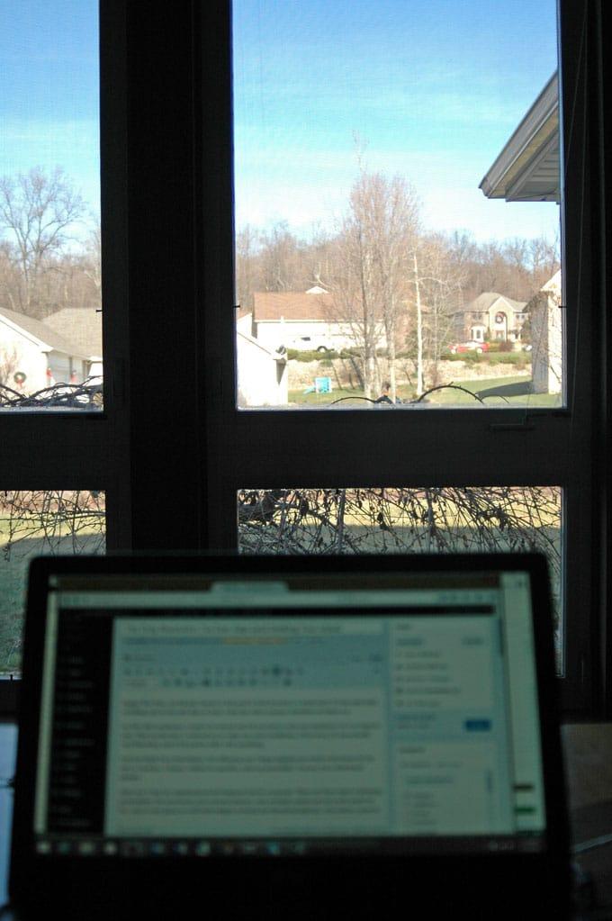laptop open in front of a window