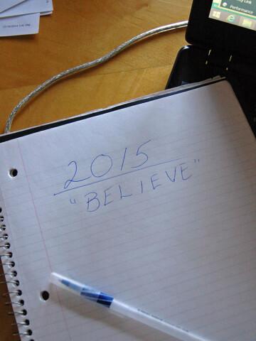 """notebook with """"2015 BELIEVE"""" written in pen"""