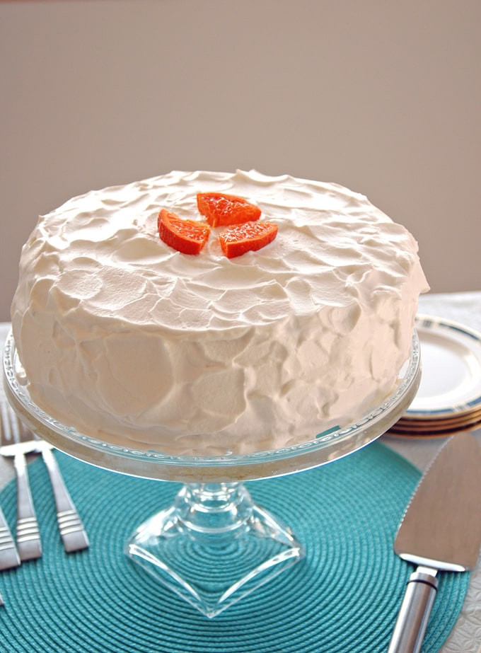 cake stand with Orange Torte with Whipped Cream