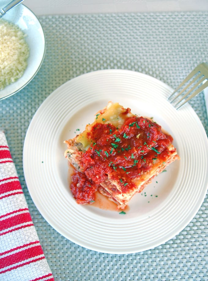 traditional lasagna on a plate with a fork