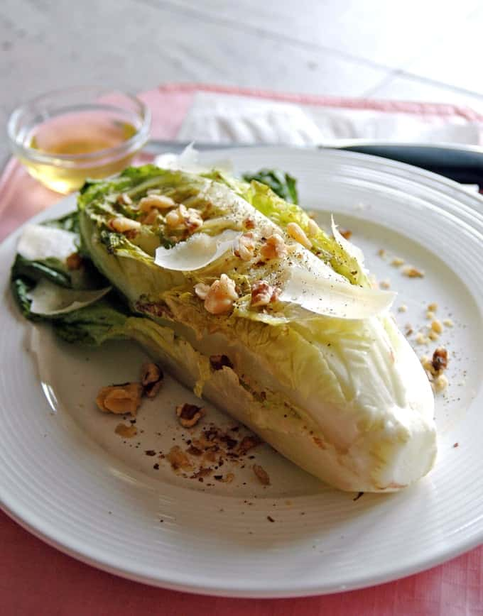 Grilled Romaine with Toasted Walnuts and Parmesan on a plate