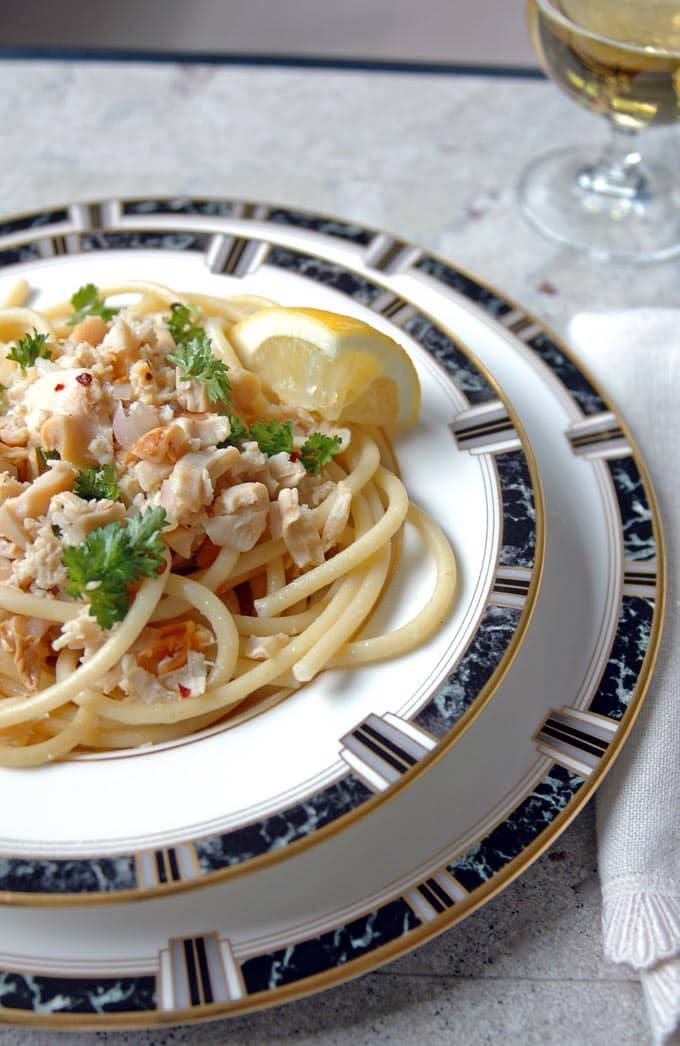 Bucatini with Clams and White Wine in a bowl on a plate