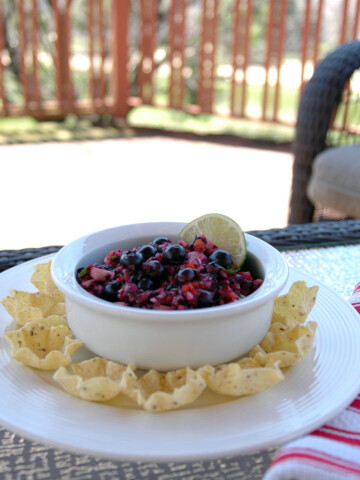 Red, White and Blueberry Salsa in a dish with chips