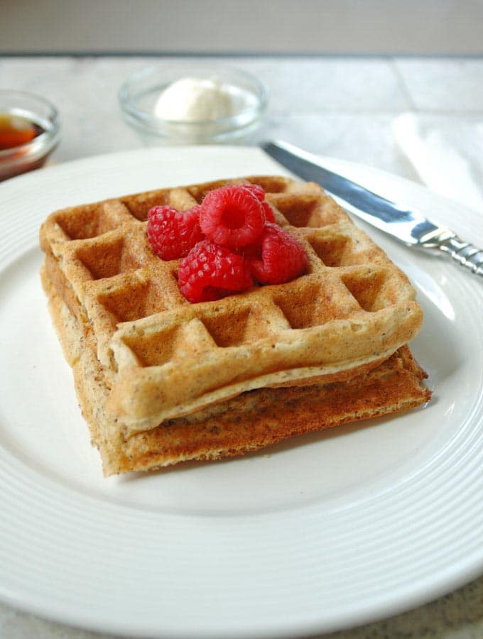 2 Buttermilk Whole Grain Waffles on a plate with a knife