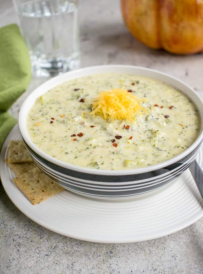 Photo of bowl of Broccoli-Cheddar Soup with Parmesan with crackers