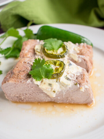 photo of sliced stuffed pork tenderloin with cream cheese and jalapenos