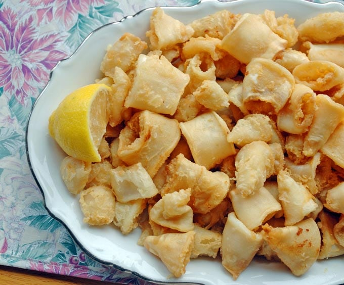 platter full of Neapolitan-Style Fried Calamari and a lemon wedge