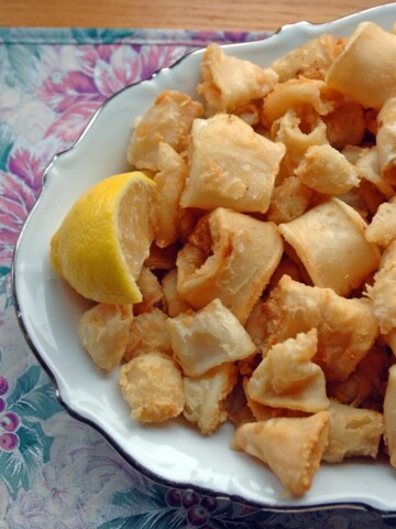 Neapolitan-Style Fried Calamari on a plate with a lemon wedge