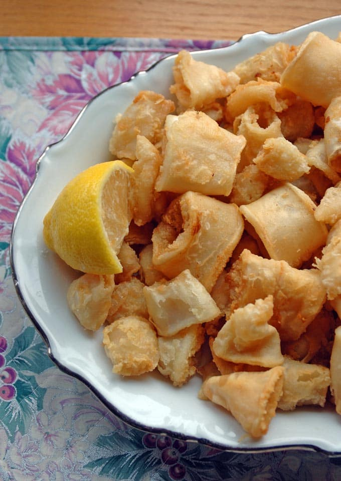 overhead view of Neapolitan-Style Fried Calamari and a lemon wedge on a plate
