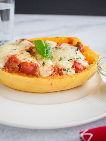side view of spaghetti squash lasagna boat on a plate