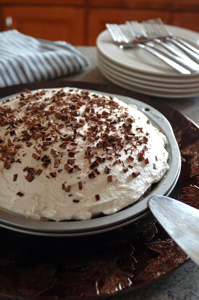 pie with whipped cream and chocolate curls