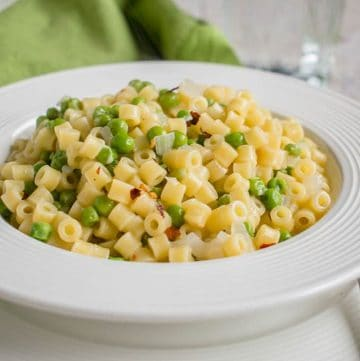 Closeup photo of bowl of Pasta e Piselli (Pasta with Peas)