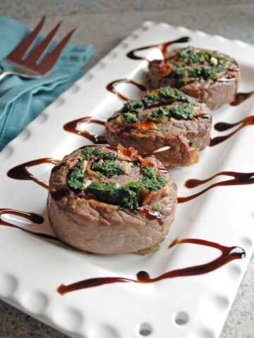 Steak Pinwheels with Bacon, Spinach and Garlic on a platter