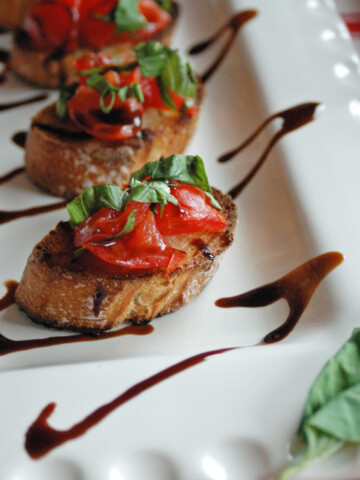 Platter of Bruschetta with Balsamic Glaze drizzled overtop