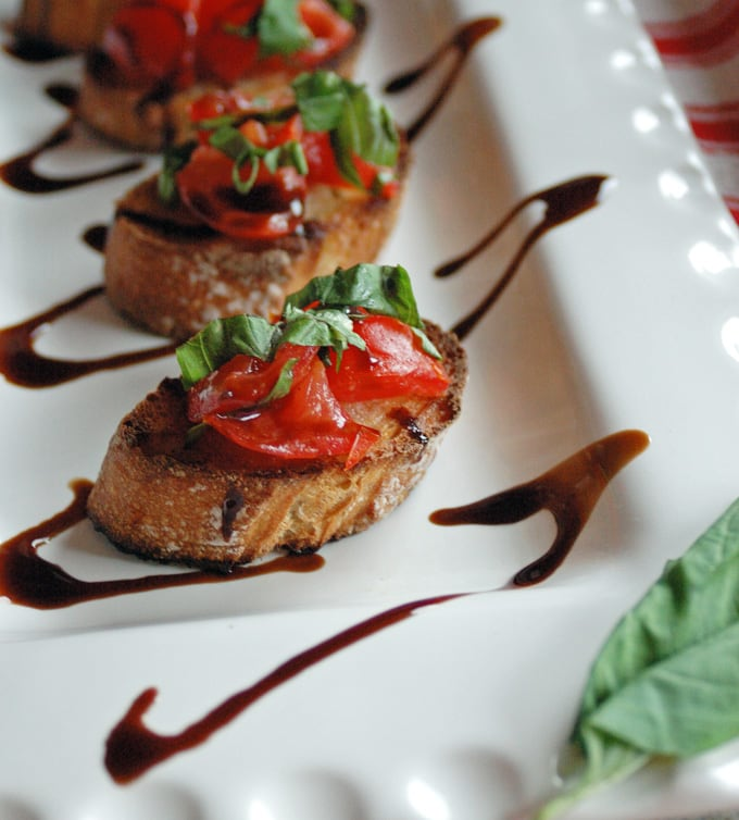 close-up photo of Tomato Bruschetta with Balsamic Glaze on a platter
