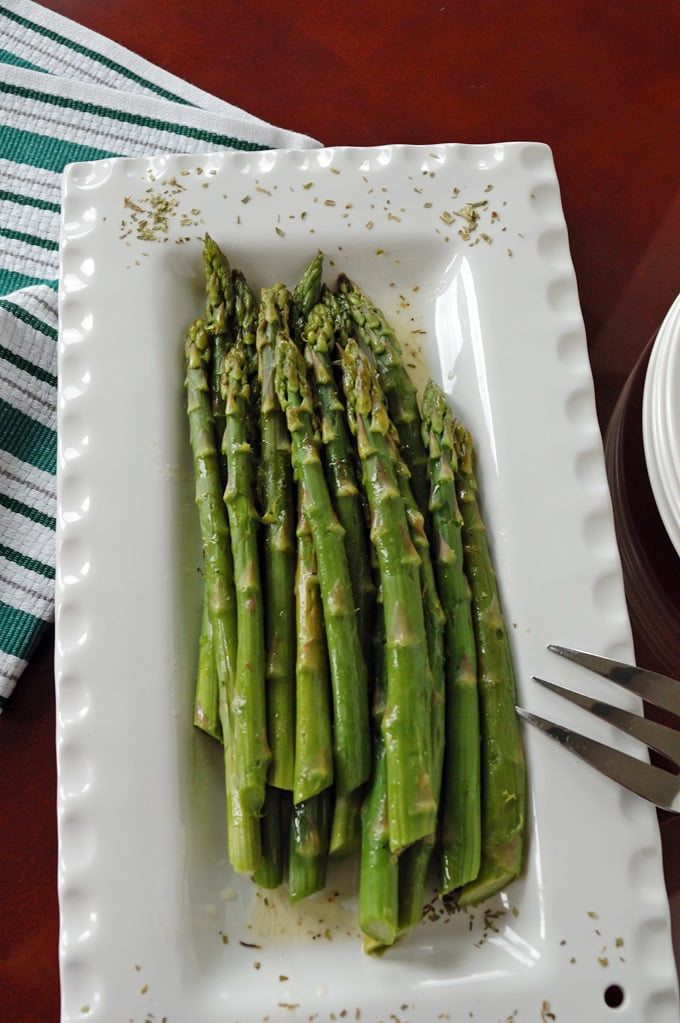 overhead view of Asparagus with Tarragon Butter and a fork