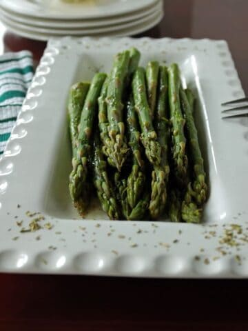 Asparagus with Tarragon Butter on a platter