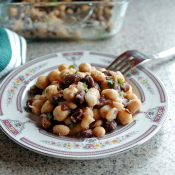 Italian bean salad in a bowl with fork