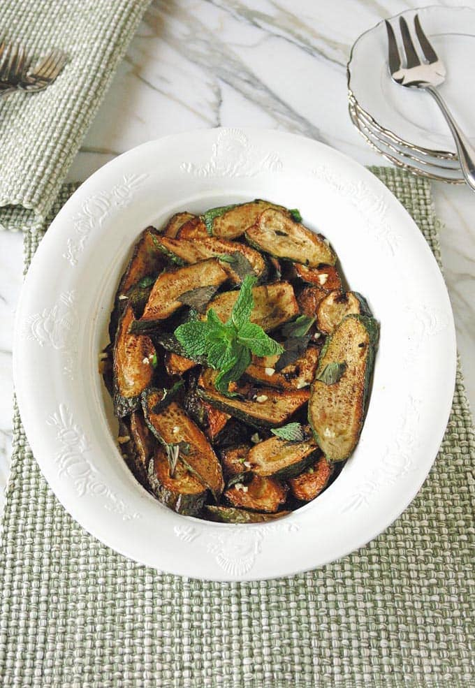 Zucchini with Mint (zucchine alla menta) is a summer dish from Naples. Zucchini are fried in oil, then topped with chopped garlic, fresh mint leaves and red wine vinegar. Vegan, gluten free and delicious!