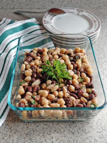 Glass container full of Italian bean salad