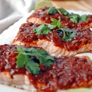 Salmon with Balsamic Salsa and Lime on a platter