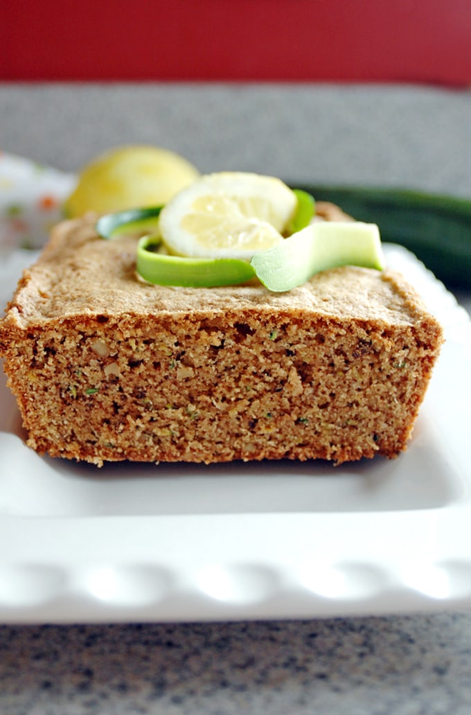 Platter of Lemony Whole Wheat Zucchini Bread topped with lemon and zucchini slices