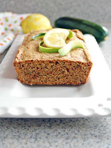 Lemony Whole Wheat Zucchini Bread topped with lemon and zucchini slices