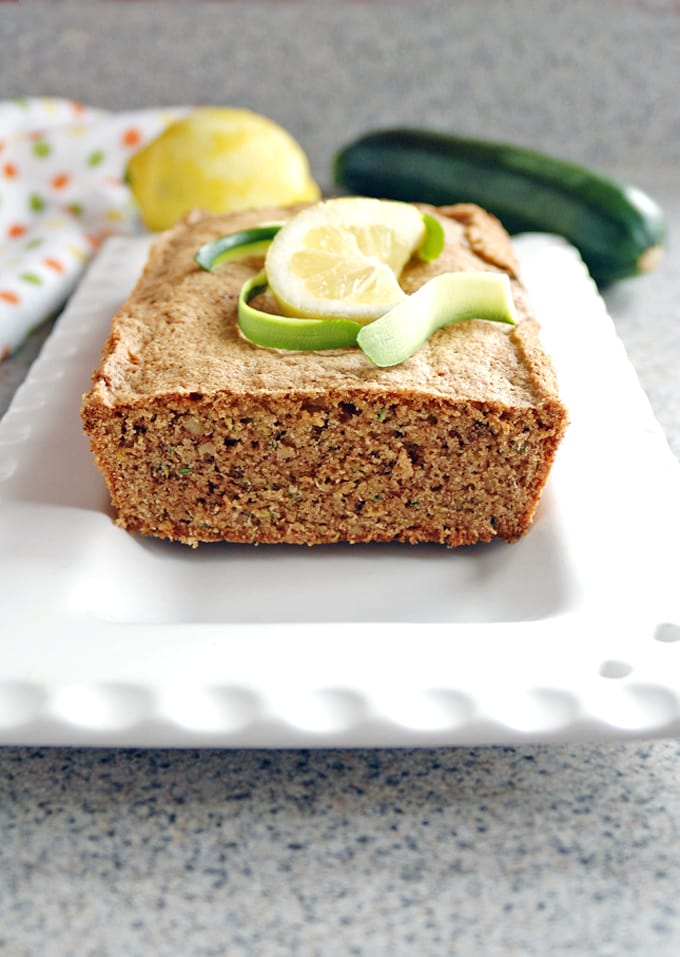 piece cut from Lemony Whole Wheat Zucchini Bread on a platter
