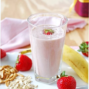 This vegan, Healthy Peanut Butter and Jelly Smoothie tastes so good and is sugar free! Fresh strawberries, peanuts and oats are the secrets to getting your breakfast smoothie to mimic the flavor of PB&J! This one keeps me full until lunch!