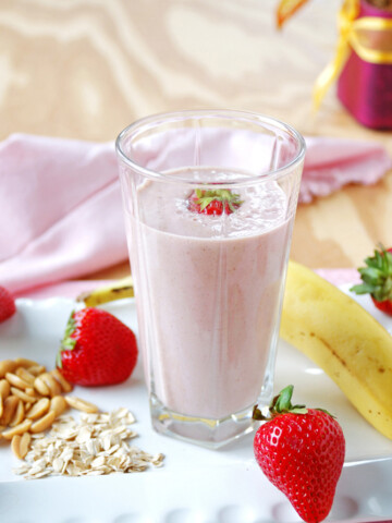 glass of Peanut Butter and Jelly Smoothie, banana, strawberries, peanuts and oats