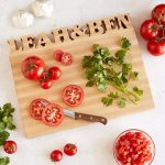 Custom cutting board with tomatoes and parsley on it