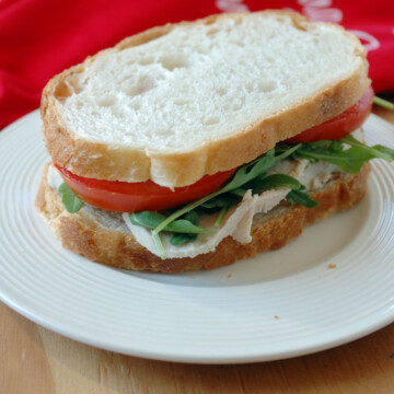 close-up of a turkey sandwich with homemade turkey lunch meat on a plate