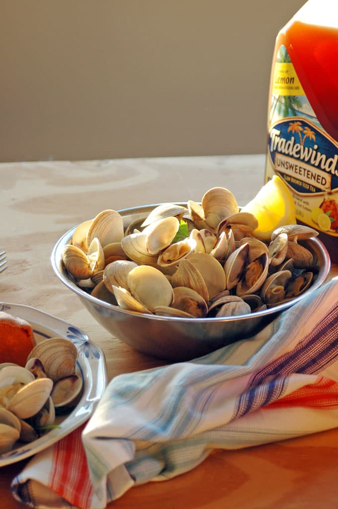 My Hubby's Beer-Steamed Littleneck Clams are so good dipped in melted butter! Plus, I'm sharing his tips for how to clean clams.