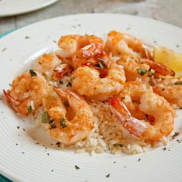 plate of Baked Parmesan Shrimp with Garlic Butter over rice