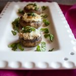 These Stuffed Mushrooms with Cream Cheese are meatless and gluten free! They're accented with lemon, basil, garlic, Parmesan, mozzarella and butter. A delicious appetizer!