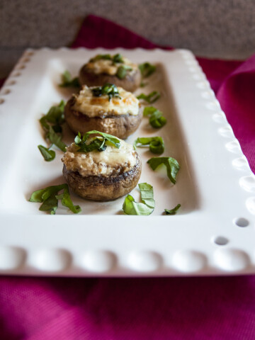 close-up of stuffed mushrooms with cream cheese on a platter