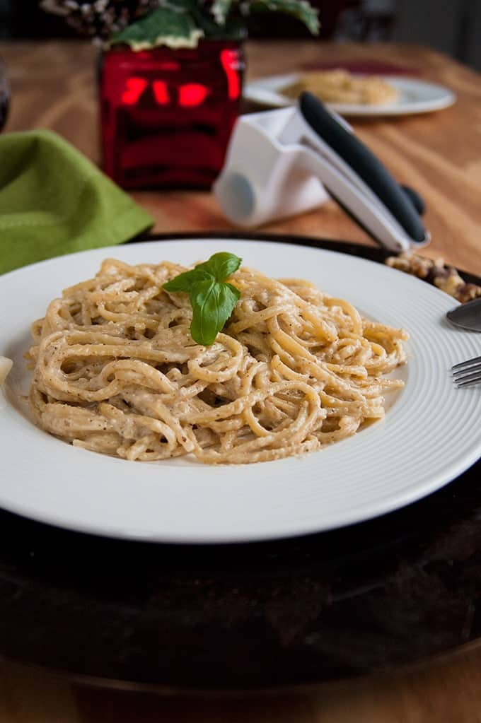side view of Linguine with Creamy Walnut Sauce on a plate