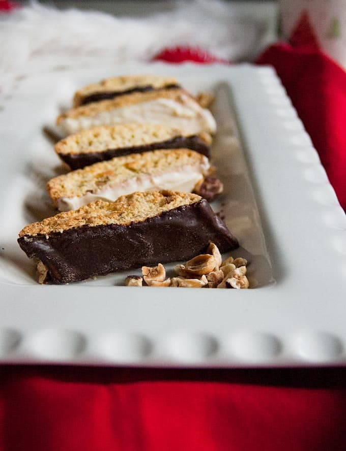 close-up of Chocolate-Dipped Hazelnut Biscotti on a platter